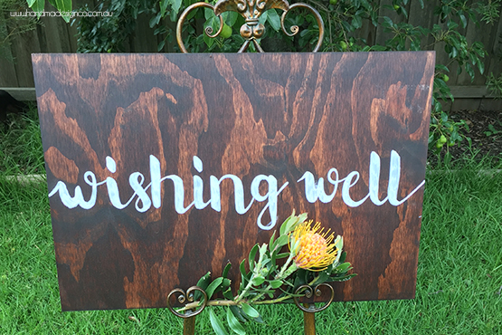 large wishing well sign